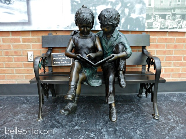 Findlay Library statue of kids reading
