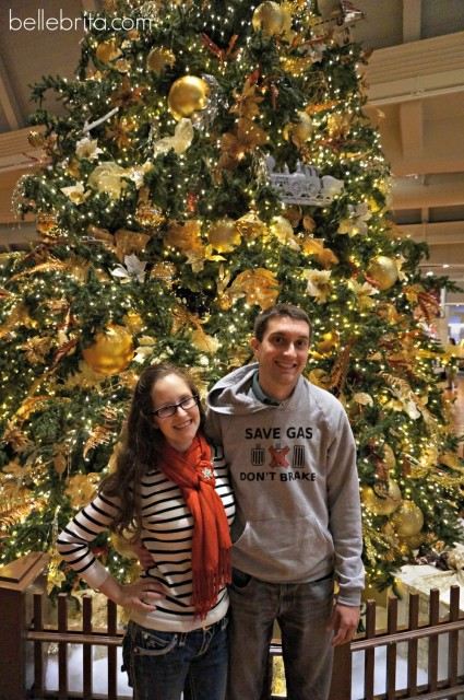Me with my husband in front of the Christmas tree at the Henry Ford Museum