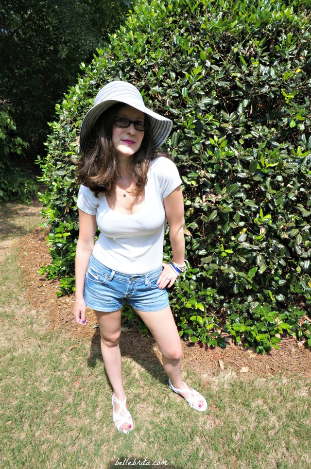 A cute and easy outfit for a hot summer day. Straw hat, white tee, denim shorts, and sandals.