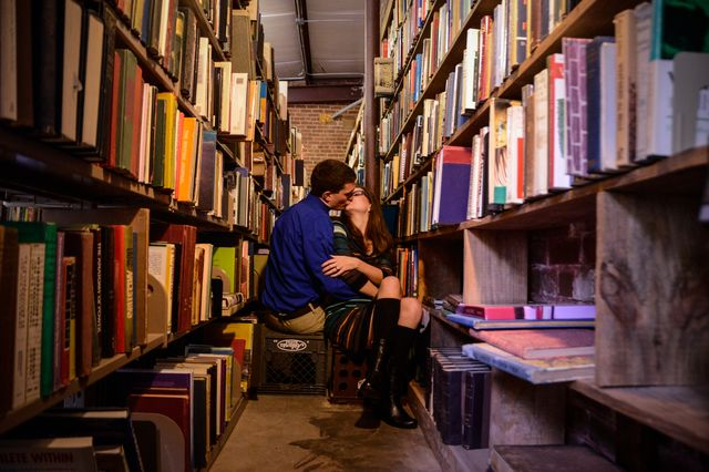 Kissing in a secondhand bookstore.