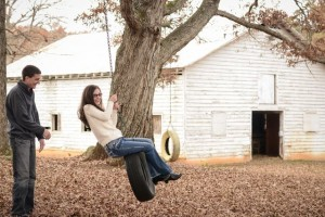 A tire swing makes for a great prop during an engagement shoot.