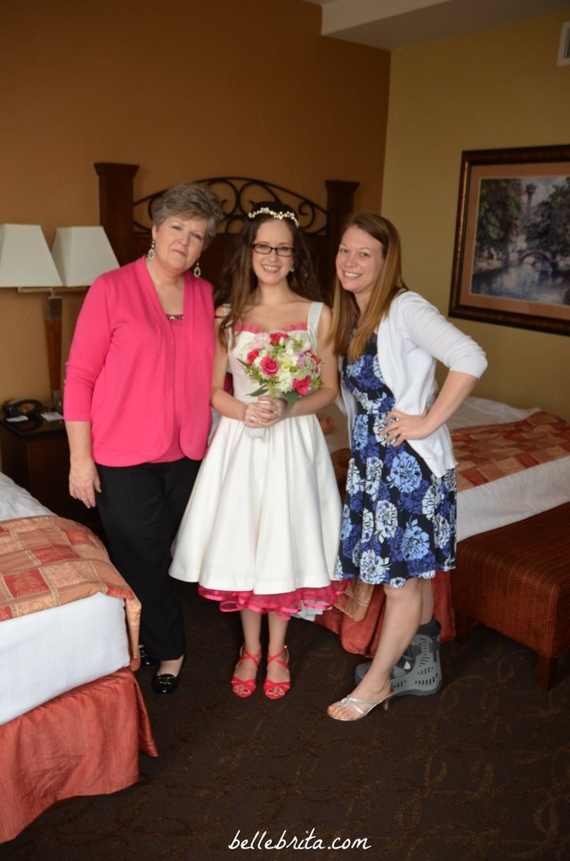 My mom and my sister-in-law helping me get dressed before the wedding