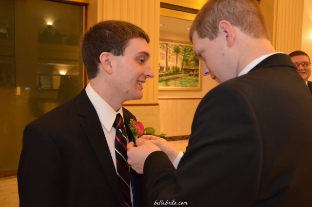 My husband's brother helping with the boutonniere before our wedding