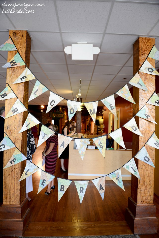 Cut pennants out of maps to create a welcome sign! | Belle Brita