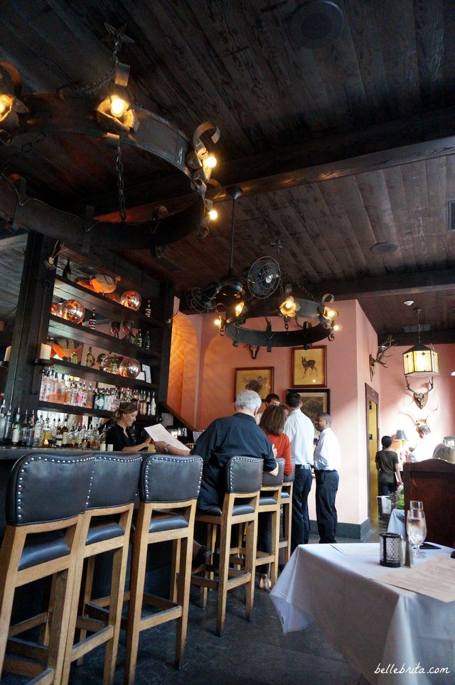 One of the dining areas at The Olde Pink House is an open-air bar that connects with the sidewalk patio.   Belle Brita