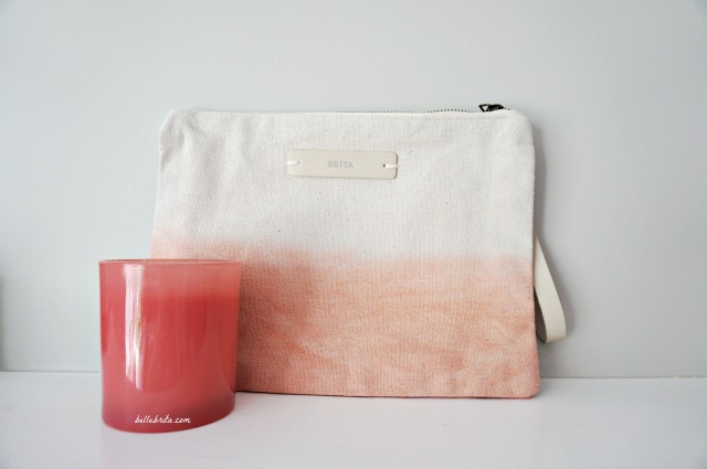 Minted sells a variety of colorful gifts at different price points, like this canvas clutch and glass candle. | Belle Brita