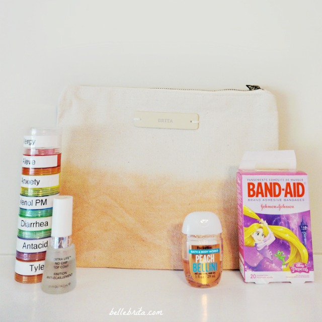 Give the bride an emergency kit to help her survive her wedding day! Pain reliever, clear nail polish, hand sanitizer, and bandages are all things to include. | Belle Brita