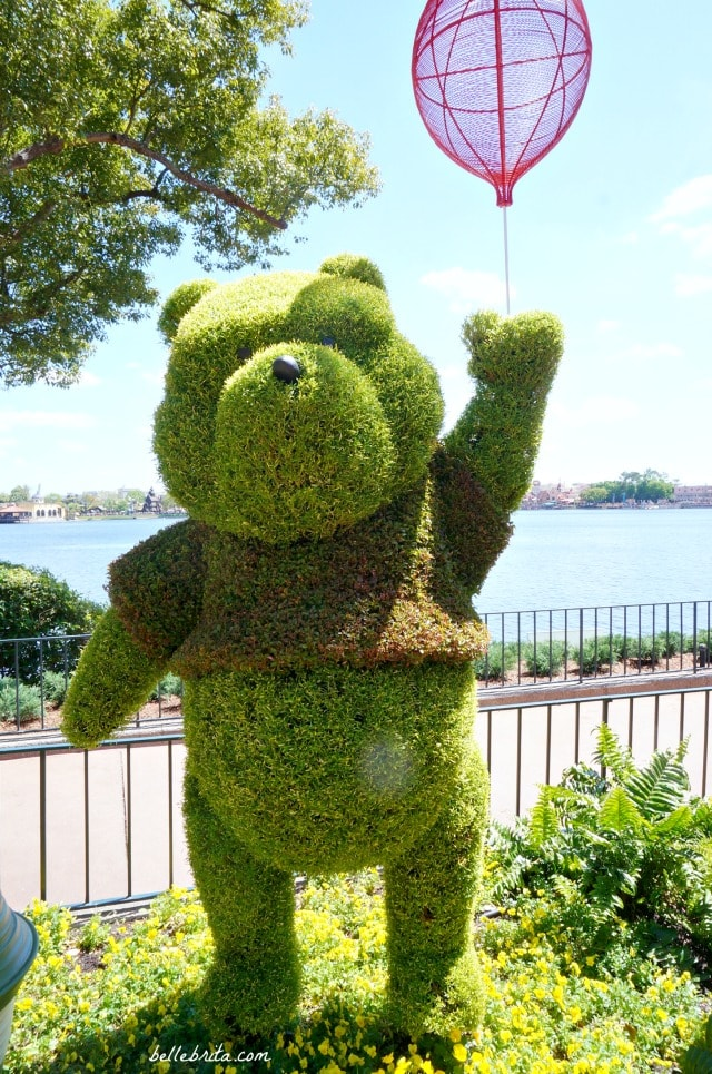 Pooh Bear, Winnie-the-Pooh Bear! This snuggly topiary was in EPCOT's United Kingdom during the 2018 Flowers and Garden Festival. | Belle Brita