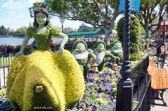 Snow White and the Seven Dwarfs are just the most delightful of topiaries in EPCOT's Germany. | Belle Brita