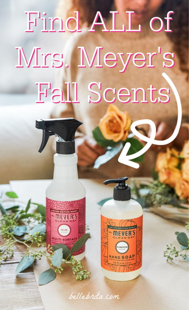 "Table with flowers, hand soap, and surface cleaner. Text overlay reads: ""Find ALL of Mrs. Meyer's Fall Scents"""