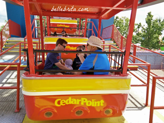 Two men, one woman, one toddler on the Ferris Wheel at Cedar Point