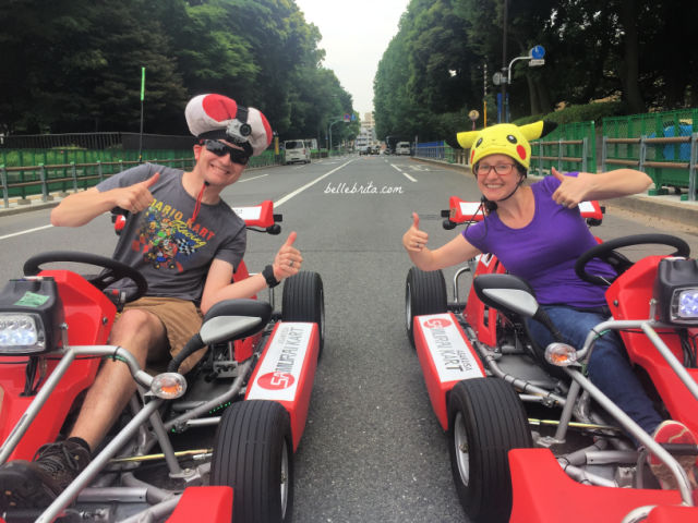 Man and woman in go-karts
