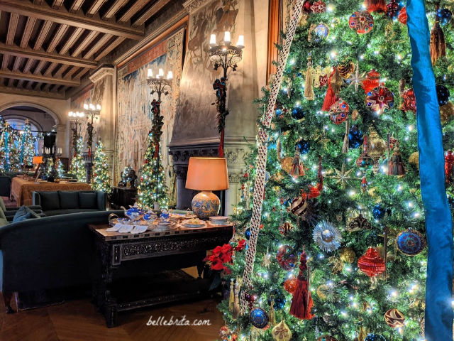 Lavishly decorated room in Biltmore, filled with Christmas trees