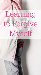 """Woman holding flowers. Text overlay reads: """"Learning to Forgive Myself"""""""