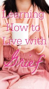 """Woman in pink holding mug. Text overlay reads: """"Learning How to Live with Grief"""""""
