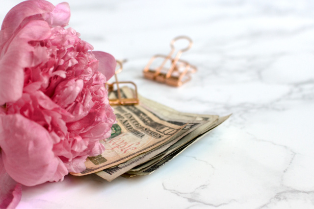 Pink peony, money, marble background