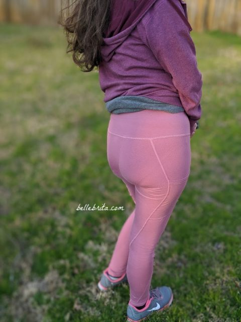Visible pantyline on a woman wearing pink leggings