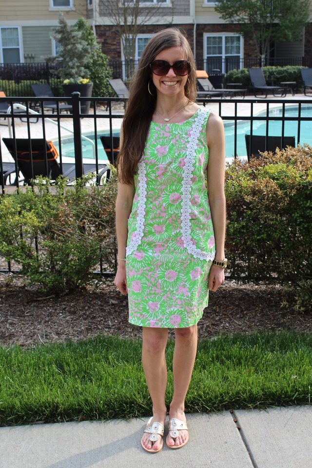 White woman wearing a pink and green Lilly Pulitzer sundress