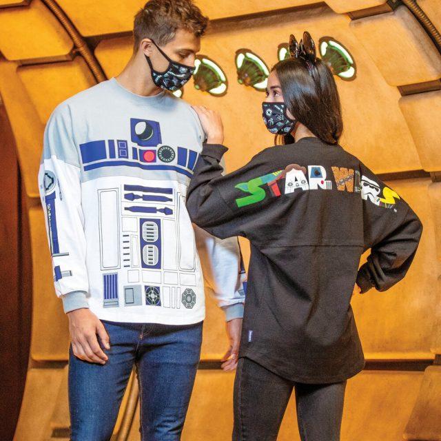 Man and woman wearing Star Wars face masks and Star Wars spirit jerseys