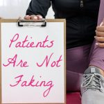 Woman in workout gear holds up a clipboard, text reading: Patients Are Not Faking