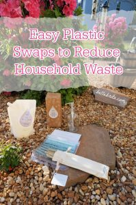 """Image of household products outside in front of an azalea bush. Text overlay reads: """"Easy Plastic Swaps to Reduce Household Waste"""""""